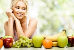 woman-looking-at-fruit
